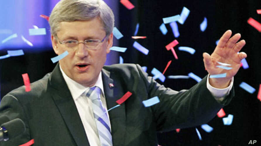 Conservative Party leader and Canadian Prime Minister Stephen Harper waves to supporters at his federal election night headquarters in Calgary, Alberta, May 2, 2011.