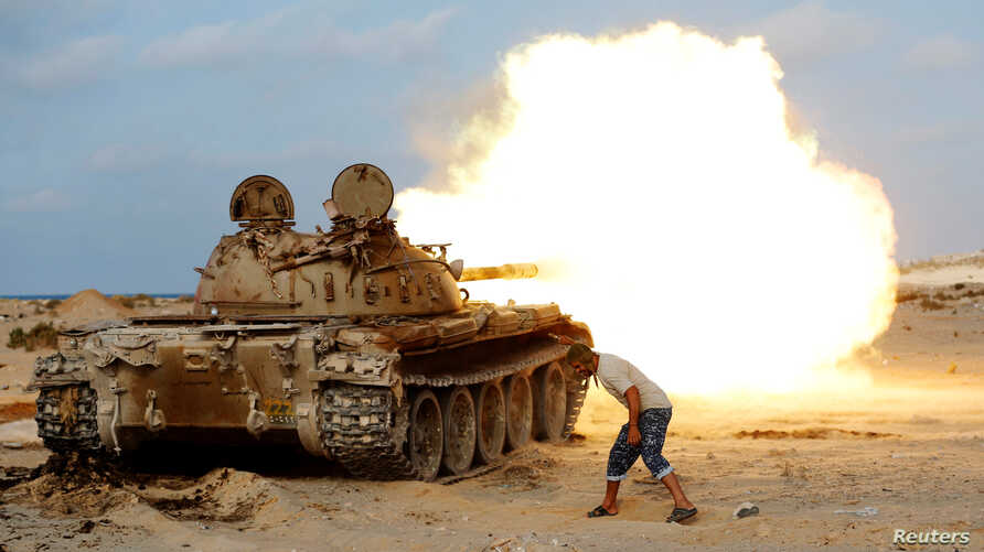 A fighter of Libyan forces allied with the U.N.-backed government fires a shell with a Soviet-made T-55 tank at Islamic State fighters in Sirte, Libya, Aug. 2, 2016.