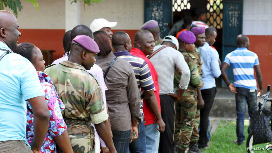 Military personnel vote at a polling station in Brazzaville, Congo, October 25, 2015.