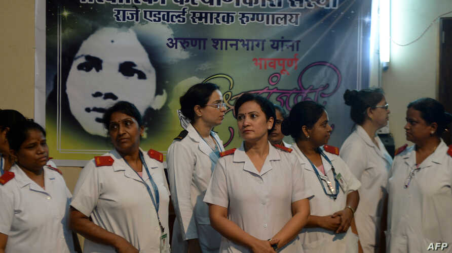 FILE - Indian nurses gather to pay their respects for nurse Aruna Shanbaug at a hospital in Mumbai, India, May 18, 2015. Shanbaug died on May 18 after 42 years in a coma following a brutal rape, in a case that led India to ease some restrictions on e