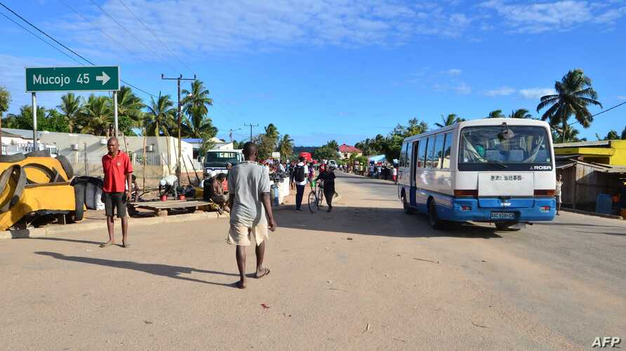 A bus drives along a street in Macomia, Cabo Delgado province, Mozambique, June 11, 2018. Cabo Delgado, expected to become the center of a natural gas industry after several promising discoveries, has seen a string of assaults on security forces and