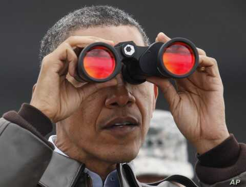 U.S. President Barack Obama looks along the border between North and South Korea at Observation Post Ouellette along the DMZ outside Seoul, March 25, 2012.