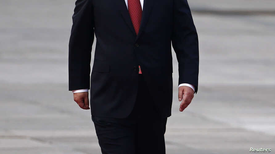 FILE - China's President Xi Jinping walks during the welcoming ceremony outside the Great Hall of the People in Beijing.