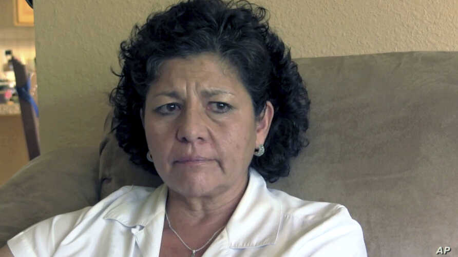 FILE - Tina Cordova talks of her late father, Anastacio Cordova, in her Albuquerque home, July 14, 2015. Cordova believes her father, who died in 2013 after suffering from multiple bouts of cancer, was affected by the atomic bomb Trinity Test in New