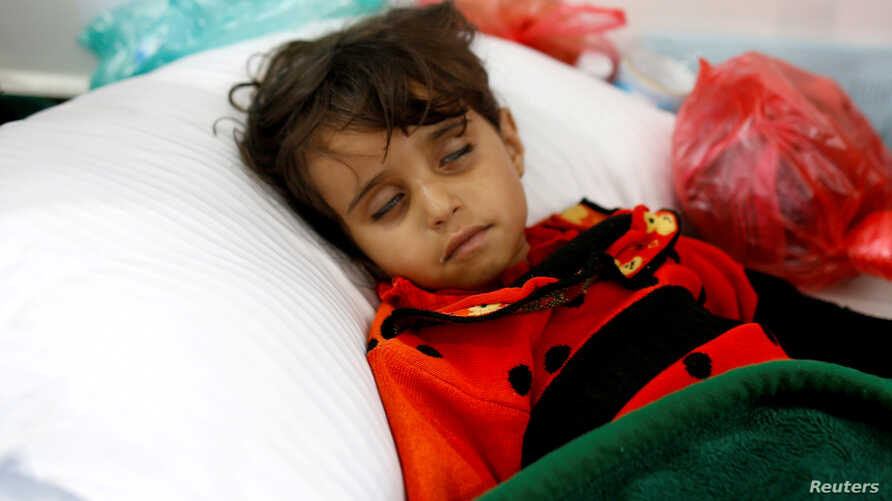 A girl infected with cholera lies on the ground at a hospital in Sanaa, Yemen May 7, 2017.