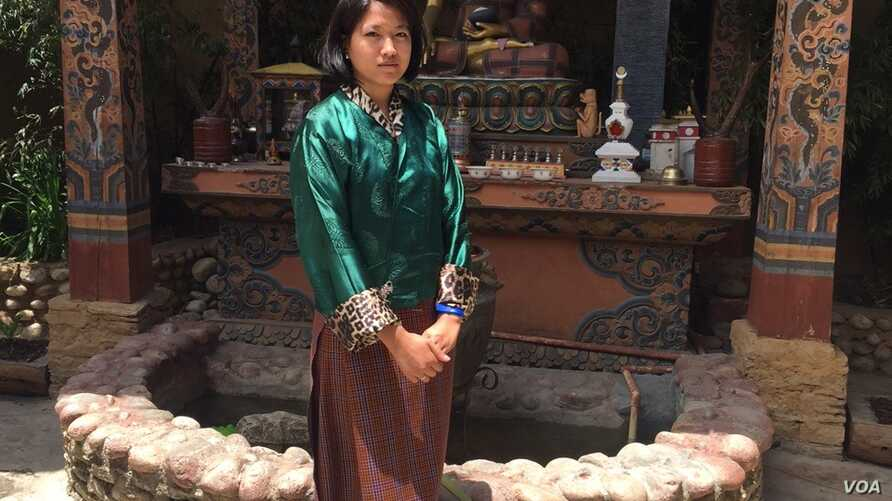 Museum guide Tashi Pelden counts herself among the fortunate few young people who have landed a job. (A. Pasricha/VOA)
