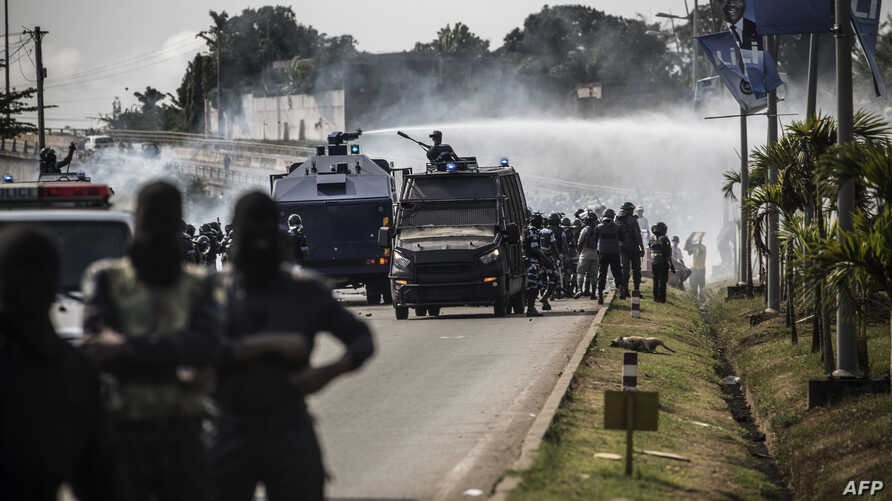 A riot police water cannon is seen spraying supporters of Gabonese opposition leader Jean Ping during clashes in Libreville on August 31, 2016, as part of a protest sparked after Gabon's president Ali Bongo was declared winner of last weekend's conte...