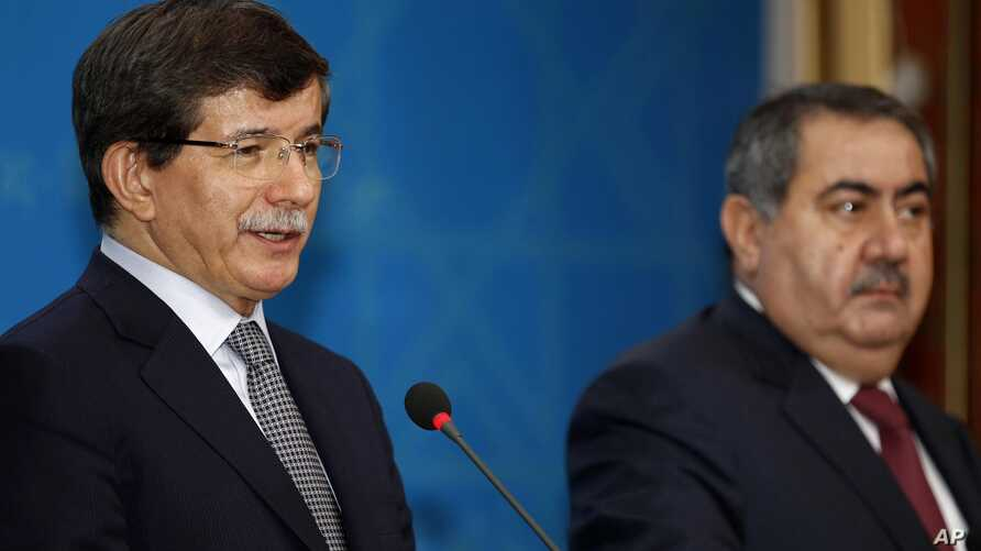 Turkish Foreign Minister Ahmet Davutoglu, left, speaks as his Iraqi counterpart Hoshyar Zebari, listens during a joint press conference in Baghdad, Iraq, Sunday, Nov. 10, 2013
