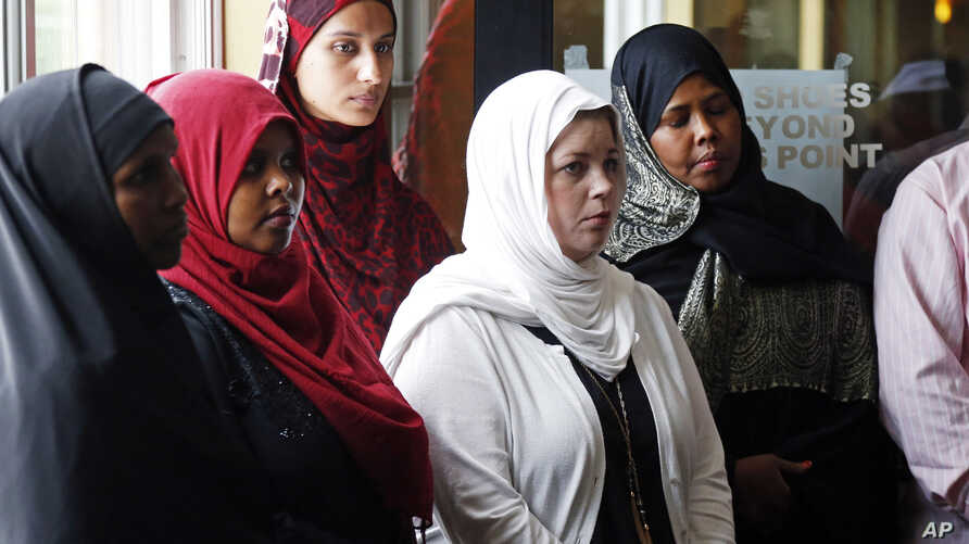 FILE - A group of women listen to Council on American-Islamic Relations-Minnesota Executive Director Jaylani Hussein, speaking about the Somali community concerns about the proposed government-initiated Countering Violent Extremism (CVE) program duri