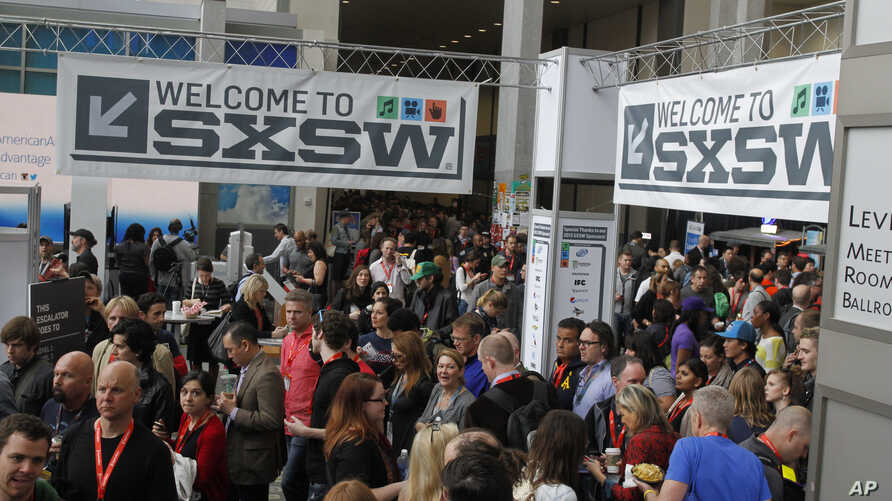 FILE - SXSW Interactive and Film Festival attendees crowd the Austin Convention Center in Austin, Texas.