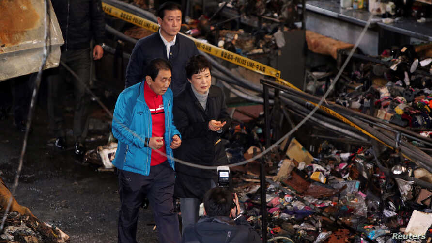 FILE - South Korean President Park Geun-hye visits the scene of a fire at a traditional market in Daegu, South Korea, Dec. 1, 2016.