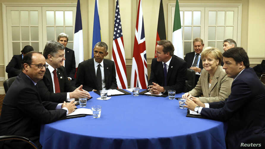 U.S. President Barack Obama joins in a meeting on the situation in Ukraine at the NATO Summit at the Celtic Manor Resort in Newport, Wales, Sept. 4, 2014.