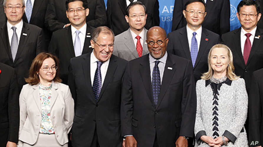 (front row) U.S. Secretary of State Hillary Clinton (R) and U.S. Trade Representative Ron Kirk (2nd R) pose with Russia's Foreign Minister Sergei Lavrov (2nd L) and Russian Minister of Economic Development Elvira Nabiullina (L) during the APEC Minist