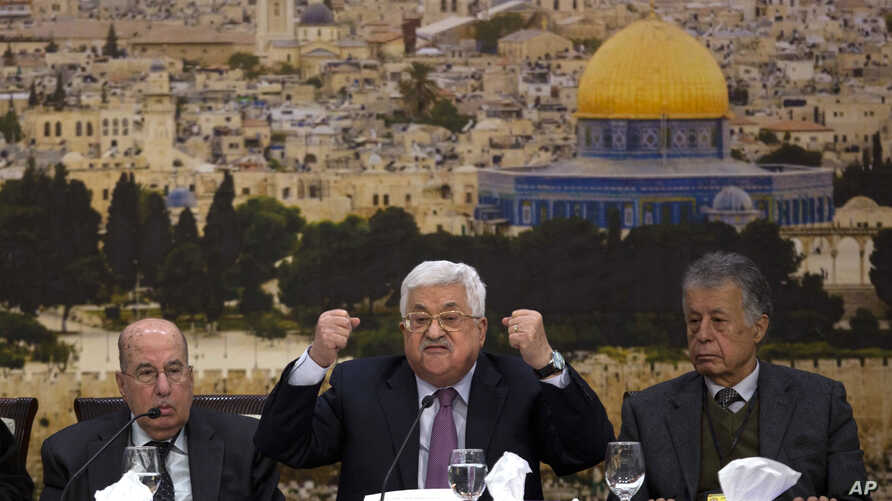 Palestinian President Mahmoud Abbas, center, speaks during a meeting with the Palestinian Central Council, a top decision-making body, at his headquarters in the West Bank city of Ramallah, Jan. 14, 2018.
