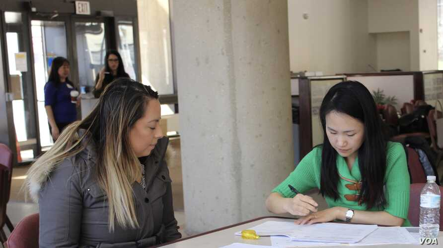 Green card holders attend a citizenship clinic in Rockville, Maryland. Under the New Americans campaign, local organizations offer free services to help legal residents become American citizens. (Photo courtesy of AAJC)