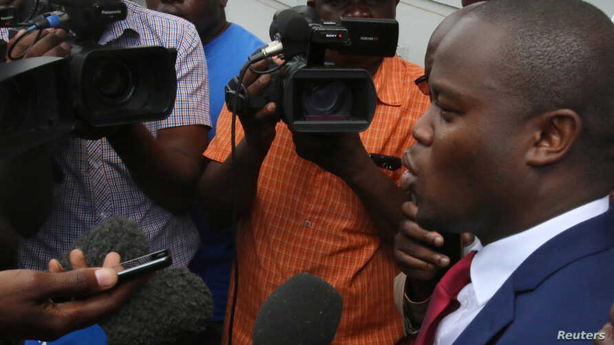 Political activist and leader of the Tajamuka/Sesjikile Movement Promise Mkwananzi speaks to the media outside the Constitutional Court in Harare, Zimbabwe, Feb. 8, 2017
