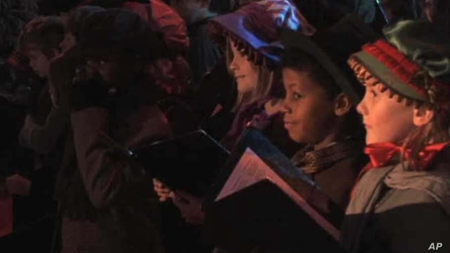 """Children in London perform for the premiere for the latest movie version of Charles Dickens' """"A Christmas Carol"""""""