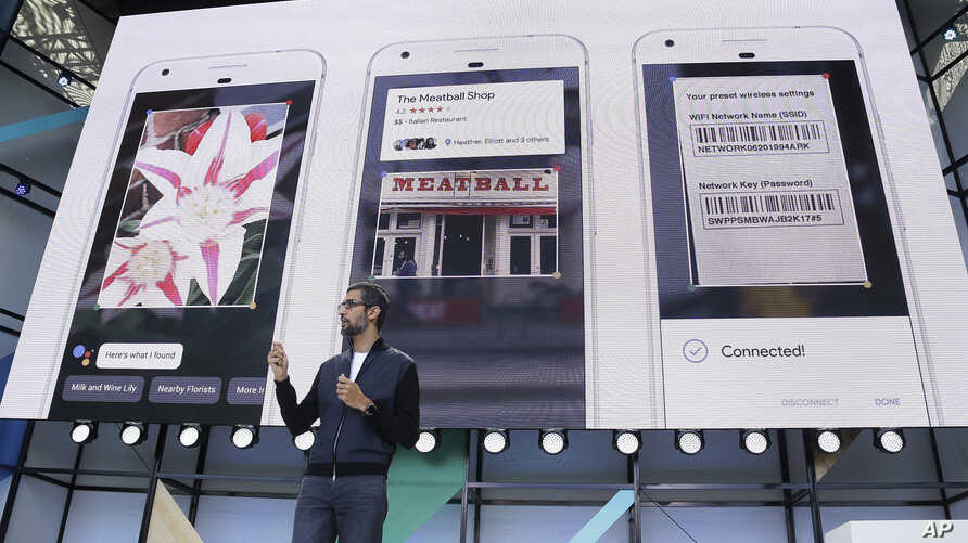 Google CEO Sundar Pichai talks about Google Lens and updates to the Google Assistant during the keynote address of the Google I/O conference in Mountain View, California, May 17, 2017.