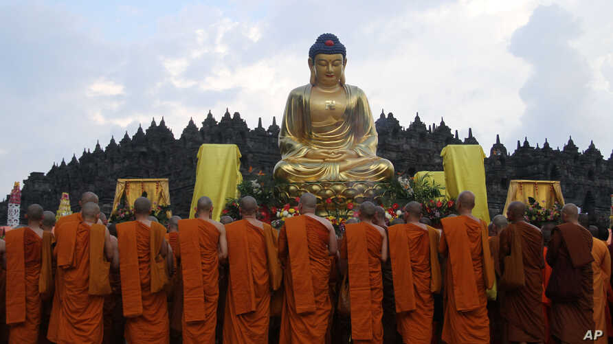 Buddhist monks gather at Borobudur temple during a celebration of Vesak day, which marks the birth, enlightenment and demise of Buddha, in Magelang, Central Java, Indonesia, Wednesday, May 14, 2014.