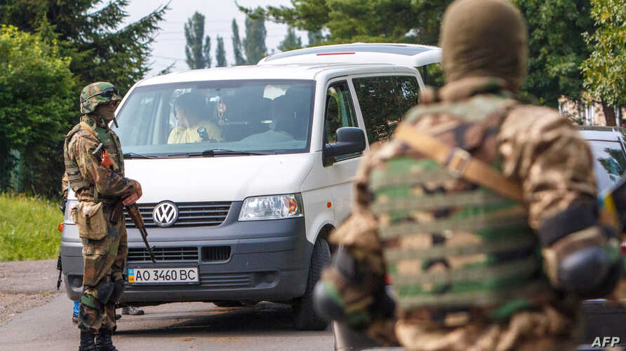 Ukrainian Security forces patrol in the village of Bobrovyshche near the small Ukrainian town of Mukacheve to locate far-right nationalist organization Pravy Sektor (Right Sector) fighters on July 14, 2015.