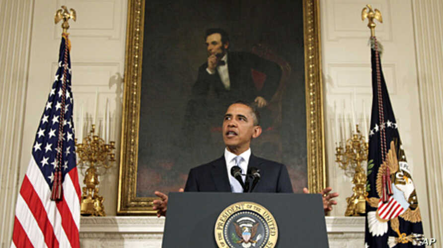 President Barack Obama speaks in the State Dining Room of the White House,  Aug. 8, 2011