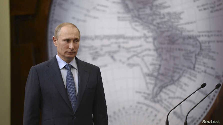 Russia's President Vladimir Putin attends a ceremony to award researchers and explorers of the Antarctic continent, in St. Petersburg, Russia, June 5, 2014.