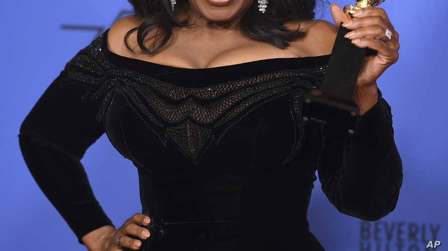 Oprah Winfrey poses in the press room with the Cecil B. DeMille Award at the 75th annual Golden Globe Awards at the Beverly Hilton Hotel on Sunday, Jan. 7, 2018, in Beverly Hills, Calif.