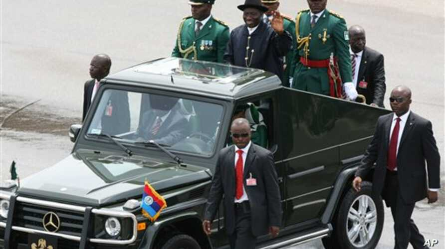 Nigerian President Goodluck Jonathan waves to the crowd during the 50th anniversary celebrations of Nigerian independence, in Abuja, Nigeria, 1 Oct 2010