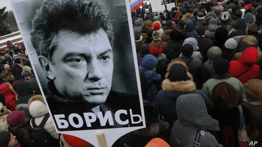 People gather in St. Petersburg, Russia, to commemorate the 2015 slaying of opposition leader Boris Nemtsov, Feb. 27, 2016.