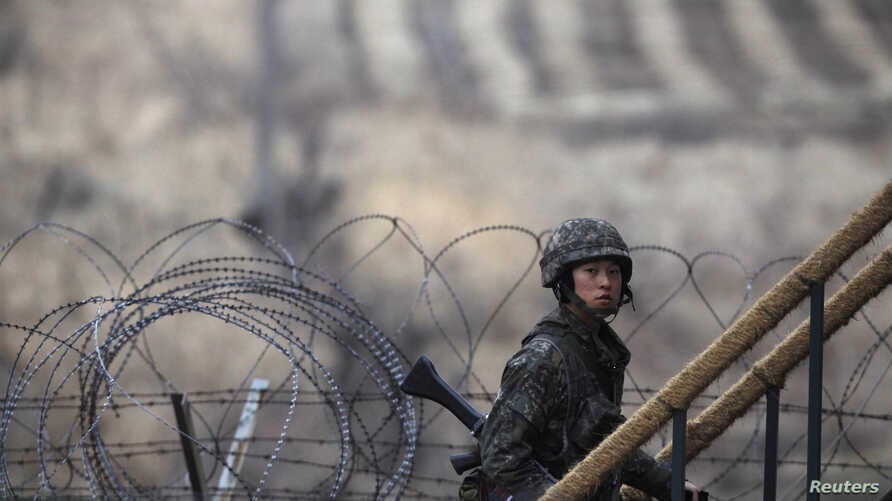 A South Korean soldier walks up the stairs at an observation post, near the demilitarized zone (DMZ) which separates the two Koreas, in Paju, north of Seoul, March 12, 2013.
