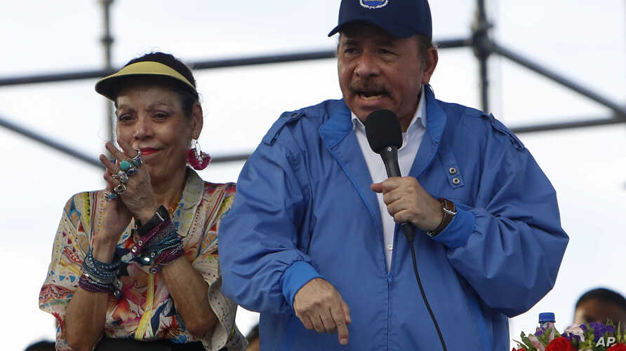 Nicaragua's President Daniel Ortega speaks to supporters as his wife and Vice President Rosario Murillo applauds, in Managua, Nicaragua, Aug. 29, 2018.