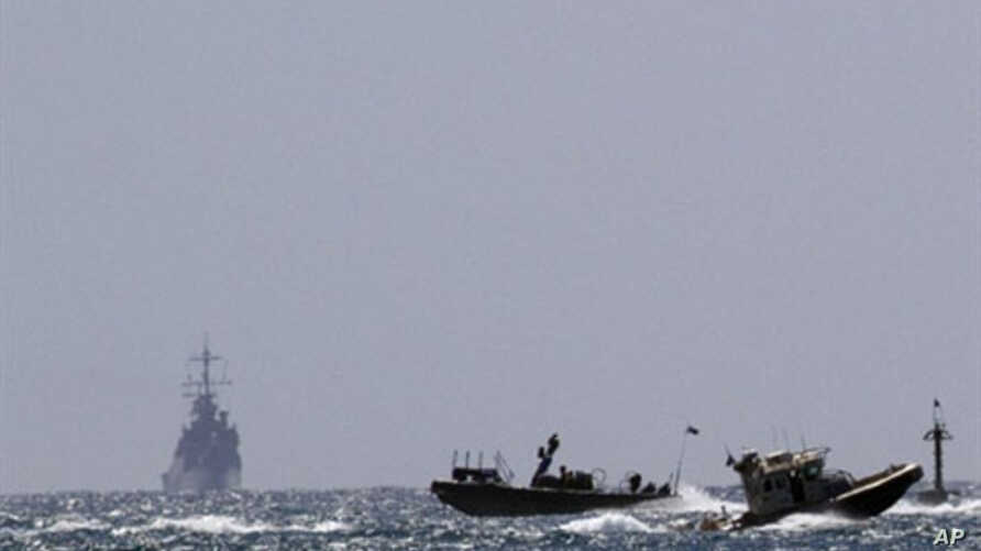 An Israeli military vessel (L) arrives at the navy port of Ashdod in southern Israel, 05 Jun 2010