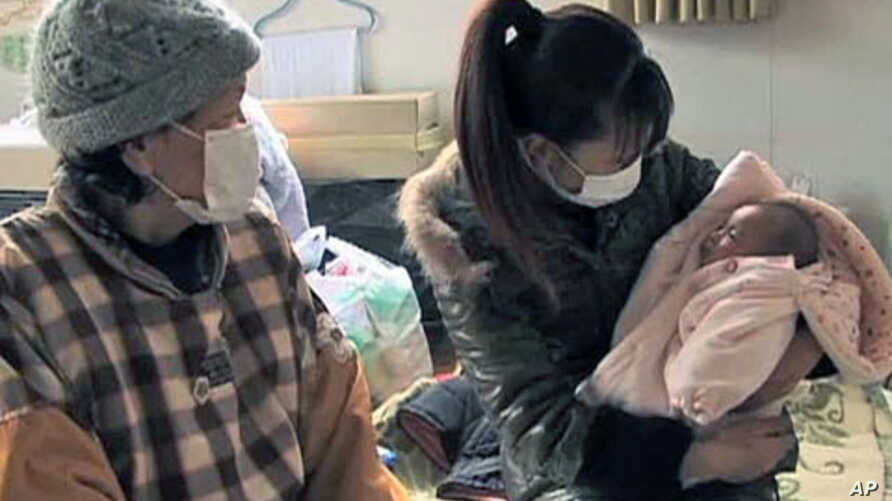 These people care for their infant, and are among more than 430,000 forced into emergency shelters after the earthquake and tsunami struck Japan on March 11 of this year, in Sendai, Japan, August 2011