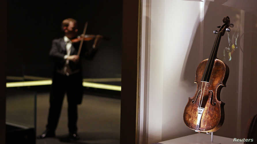 The violin that belonged to Titanic bandmaster Wallace Hartley is seen on display at the Titanic Centre in Belfast in this September 18, 2013 file photograph. The violin was sold on October 19, 2013 for 900,000 pounds ($1.45 million) at Henry Aldridg