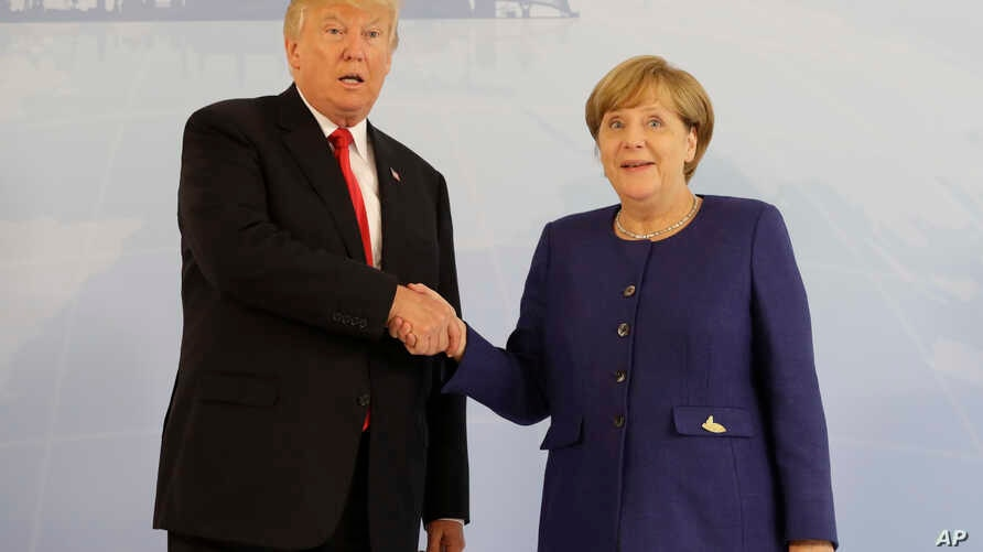 U.S. President Donald Trump and German Chancellor Angela Merkel pose for a photograph before a bilateral meeting on the eve of the G-20 summit in Hamburg, Germany, July 6, 2017. The leaders of the Group of 20 meet July 7 and 8.