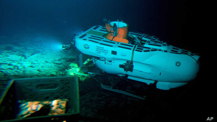 The Pisces IV submersible sits atop the summit of Cook seamount, as seen from the Pisces V craft, during a dive to the previously unexplored underwater volcano off the coast of Hawaii's Big Island on Sept. 6, 2016.