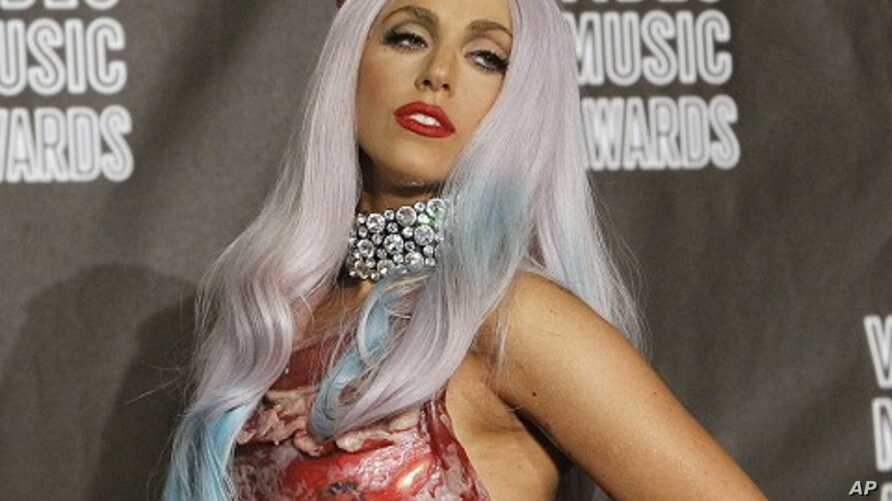Lady Gaga poses in the photo room at the 2010 MTV Video Music Awards in Los Angeles