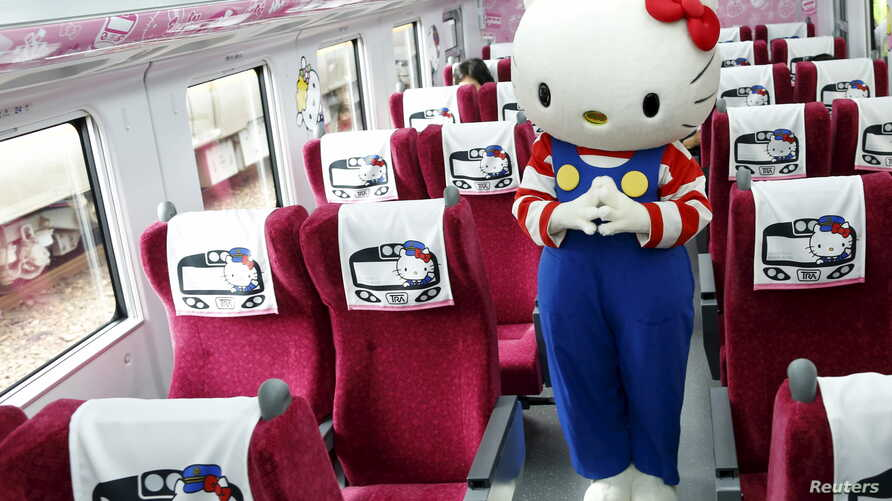A performer dressed as a Hello Kitty poses inside a Hello Kitty-themed Taroko Express train in Taipei, Taiwan March 21, 2016.