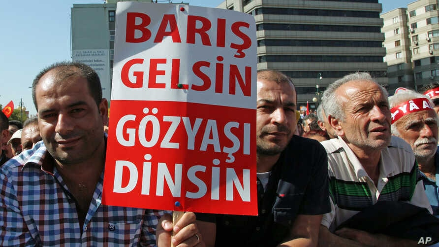 """FILE-Thousands of Alevi Muslims, members of Turkey's largest religious minority group, with some holding banners that read """"Let's make peace and stop bloodshed"""" rally in Ankara."""