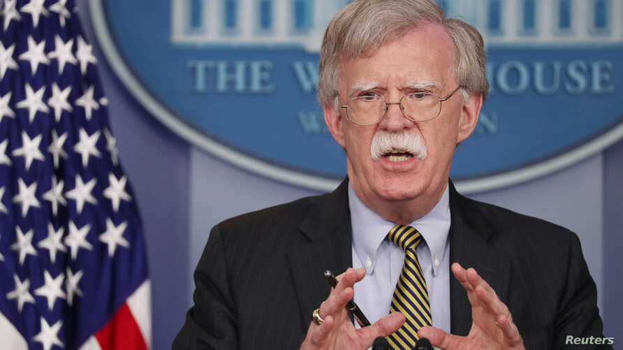 """U.S. National Security Adviser John Bolton answers questions from reporters after announcing that the U.S. will withdraw from the Vienna protocol and the 1955 """"Treaty of Amity"""" with Iran in the White House briefing room in Washington, Oct. 3, 2018."""