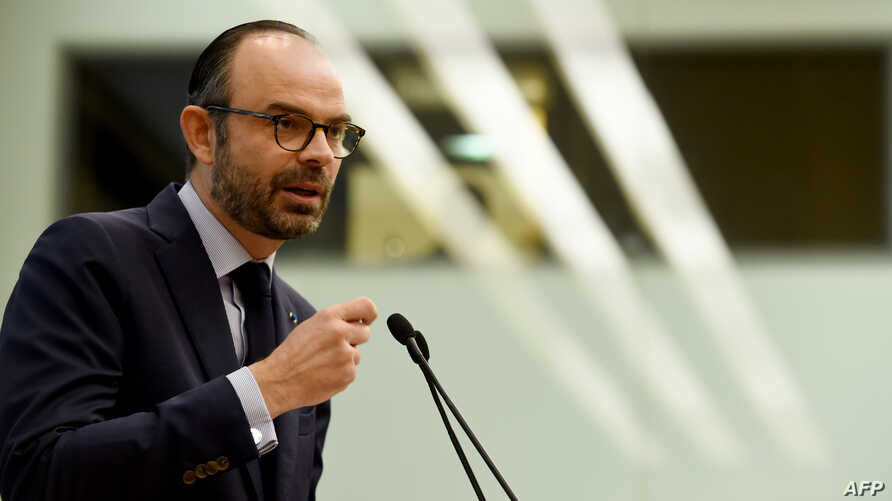 """French Prime Minister Edouard Philippe addresses the opening of the """"Great Gathering of Productive Investment"""" at the National Assembly  in Paris on Jan. 22, 2018."""