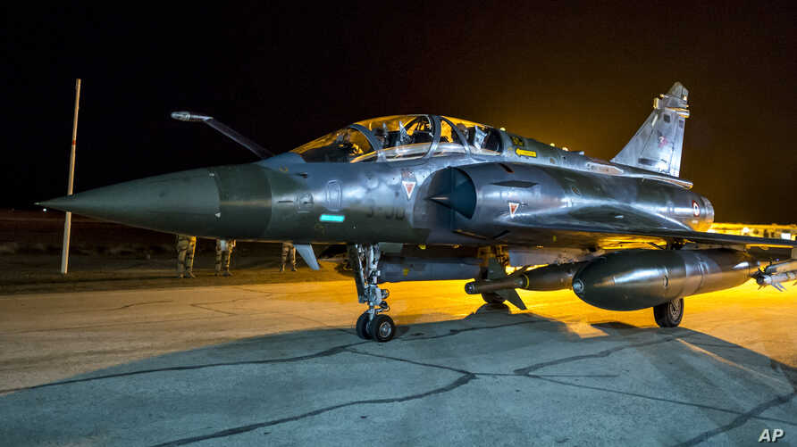 This photo released Nov. 9, 2015, by the French Army shows a French Mirage 2000 jet on the tarmac of an undisclosed air base as part of France's Operation Chammal launched in September 2015 in support of the U.S-led. coalition against Islamic State g