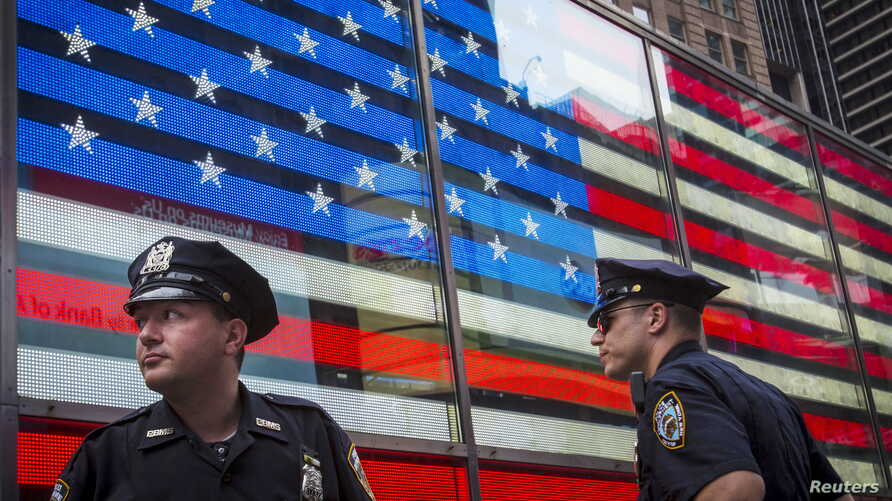 Police officers patrol Times Square in New York City, July 3, 2015.