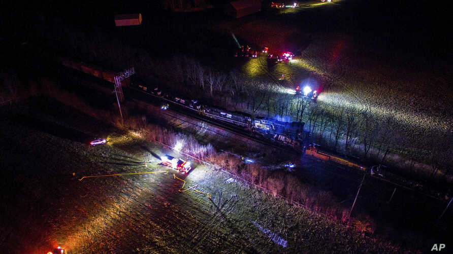This photo provided by Nicholas Waun shows the scene where two trains collided and derailed in Georgetown, Ky., early Monday, March 19, 2018.