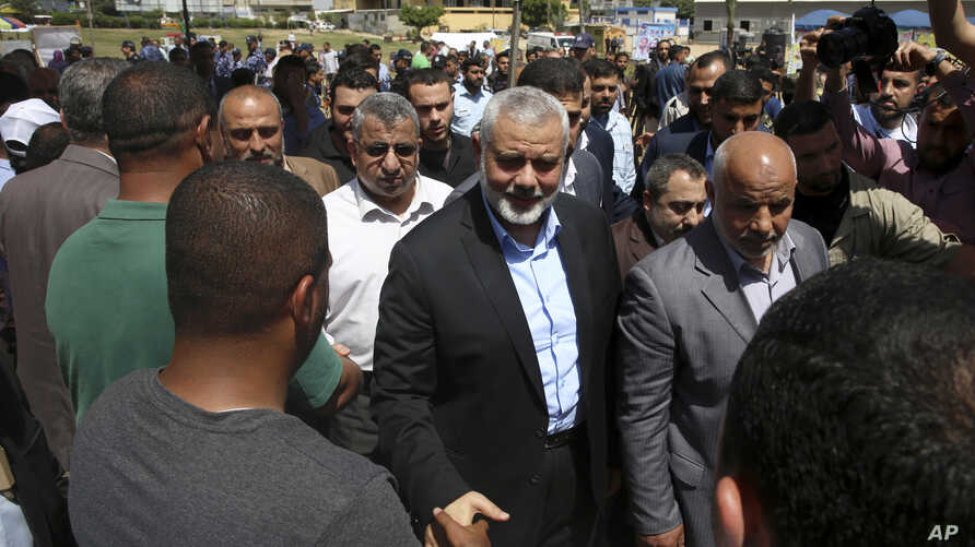 Ismail Haniyeh, new Hamas leader, center, shakes hands with a crowd member upon his arrival to a solidarity tent for hunger-striking Palestinian prisoners held by Israel, at the main square in Gaza City, May 8, 2017.