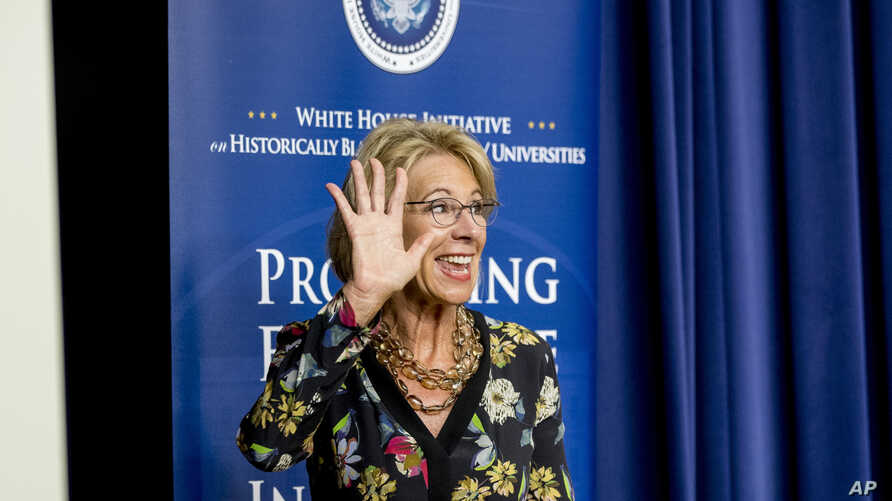 U.S. Education Secretary Betsy DeVos waves as she steps away from the podium after speaking at the White House, in Washington, Sept. 18, 2017.