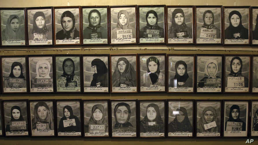 FILE - Mug shots of former prisoners hang on the wall at a former prison run by the pre-revolution intelligence service, Savak, now a museum, in downtown Tehran, Jan. 7, 2019.