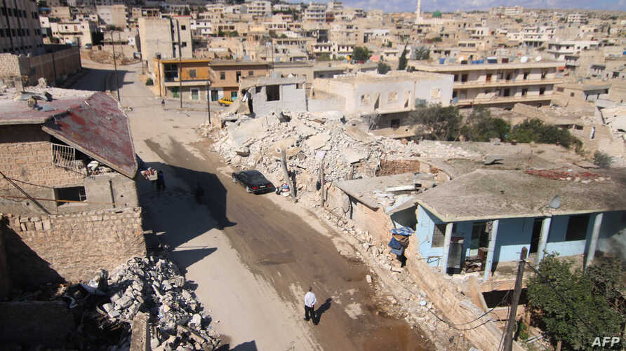A general view shows damaged buildings in the town of Darat Azzah, west of the northern Syrian city of Aleppo, following reported bombings by government forces, Oct. 7, 2015.