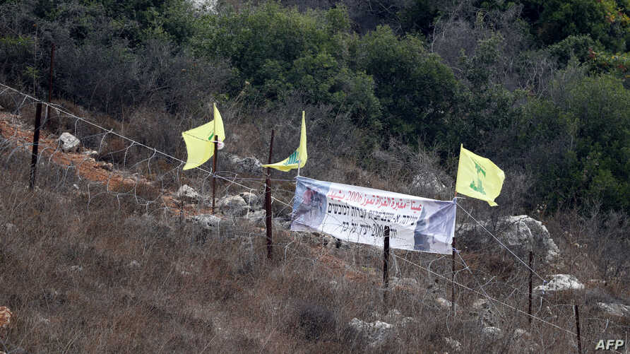 """Hezbollah's flags fly at """"Point 105"""" on the Israel-Lebanon border, Aug. 2, 2018."""