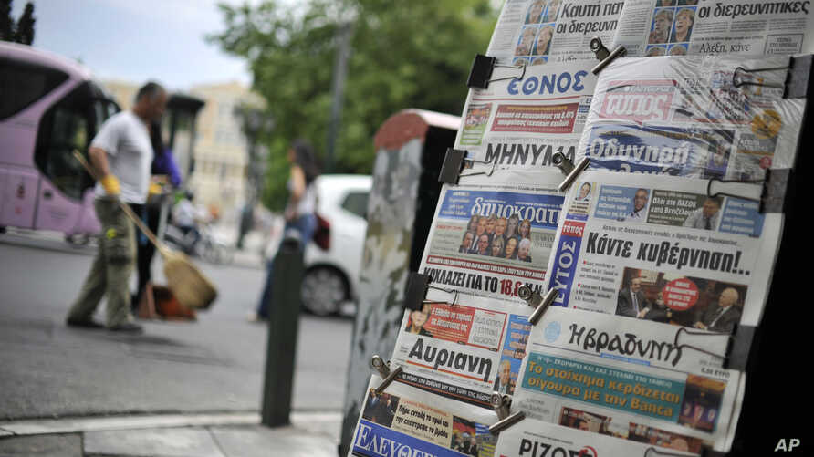Newspapers are displayed in Athens, May 8, 2012. Europe's most indebted nation plunged into deep uncertainty after an election in which voters rejected mainstream pro-austerity parties.